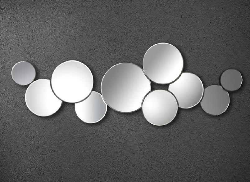 Espejos circulos alineados for Espejos circulares pared