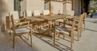 Set de comedor exterior extensible 2 - Mesa de circular madera con sillones.