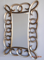 Espejo rectangular marco espirales acabado oro - Medidas: 148 x 100 cm