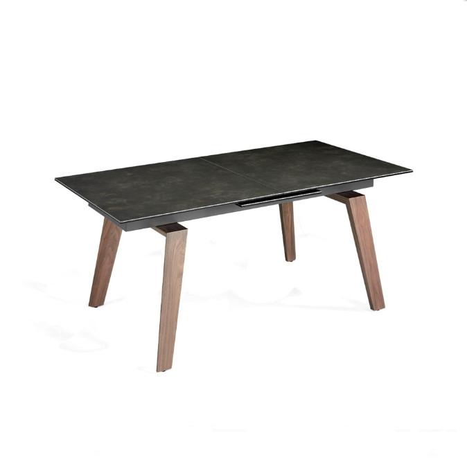 Mesa de comedor con extensibles, base fabricada en madera maciza chapada en Nogal