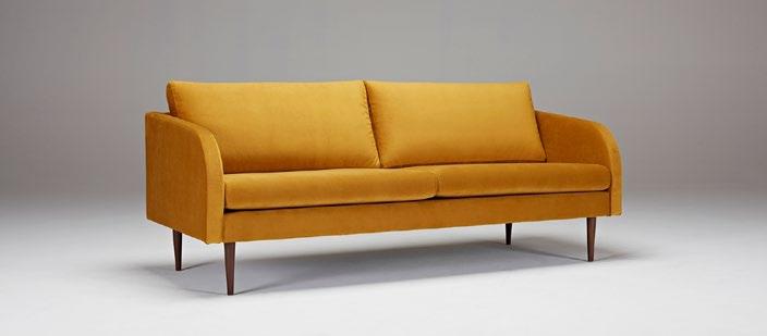 Sofá Hugo - Un diseño clásico de mediados de siglo con los brazos redondeados completamente tapizados característicos y piernas styletto