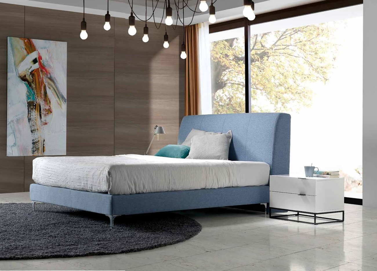CAMA MODELO SOHO - CAMA MODELO SOHO. Cama doble de canapé fijo y cabecero acolchado con costuras verticales.