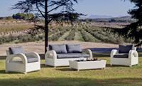 Set de sillones modulares - Set de muebles de exterior fabricados con fibra de color claro y con cómodos cojines para disfrutar del buen tiempo.